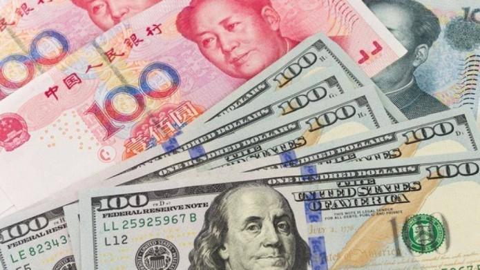 Giá USD tăng, trong khi giá đồng Nhân dân tệ giảm