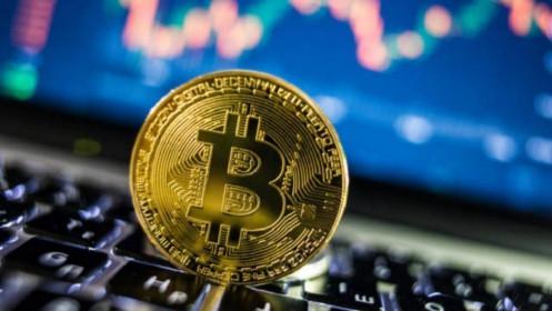 Bitcoin đột phá 58,000 USD, tăng 100% từ đầu năm