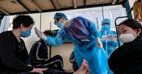 Việt Nam miễn phí điều trị COVID-19, các nước ra sao?