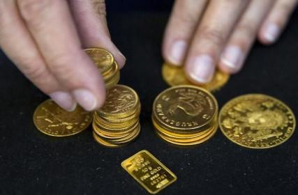Vàng giảm, đồng Đô la và lợi suất trái phiếu tăng trước khi Mỹ công bố dữ liệu lạm phát