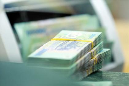 Dòng tiền 63.000 tỉ đồng của Kho bạc Nhà nước giúp lãi suất hạ nhiệt
